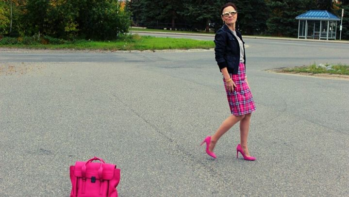 Alaskan fashion blogger donning a plaid skirt