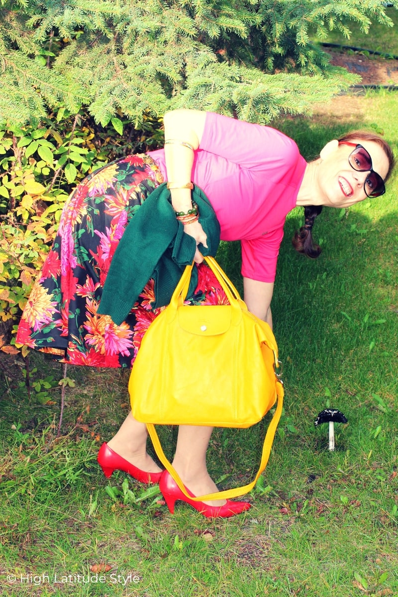 Alaskan woman bending down in pink, red, yellow look