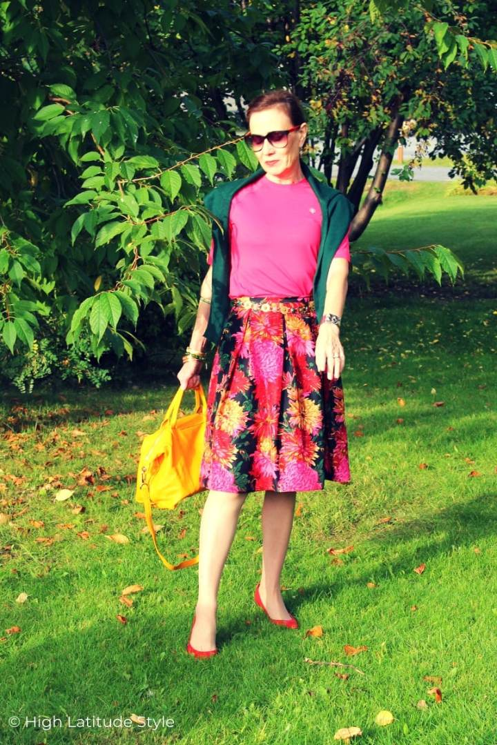 fashion blogger in summer skirt styled for fall with a sweater