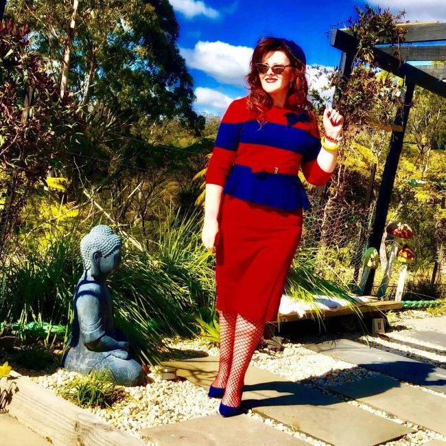 Top of the World Style Winner Donna in a red skirt and matching red blue sweater blue pumps in Australia