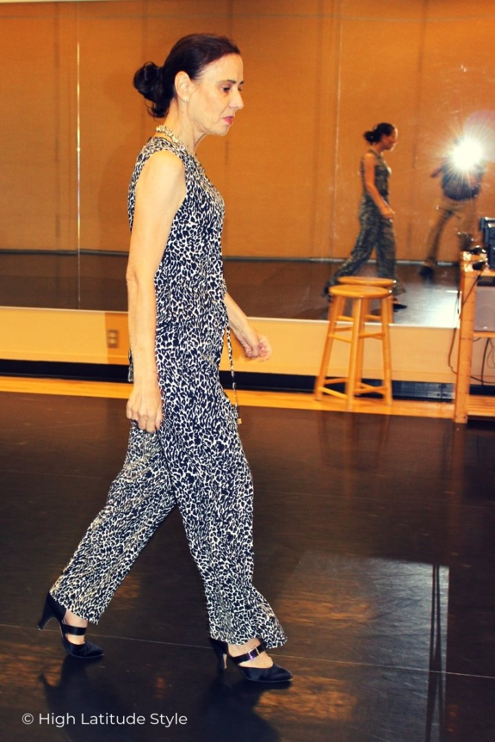 mature woman walking in tank and matching trousers in animal print