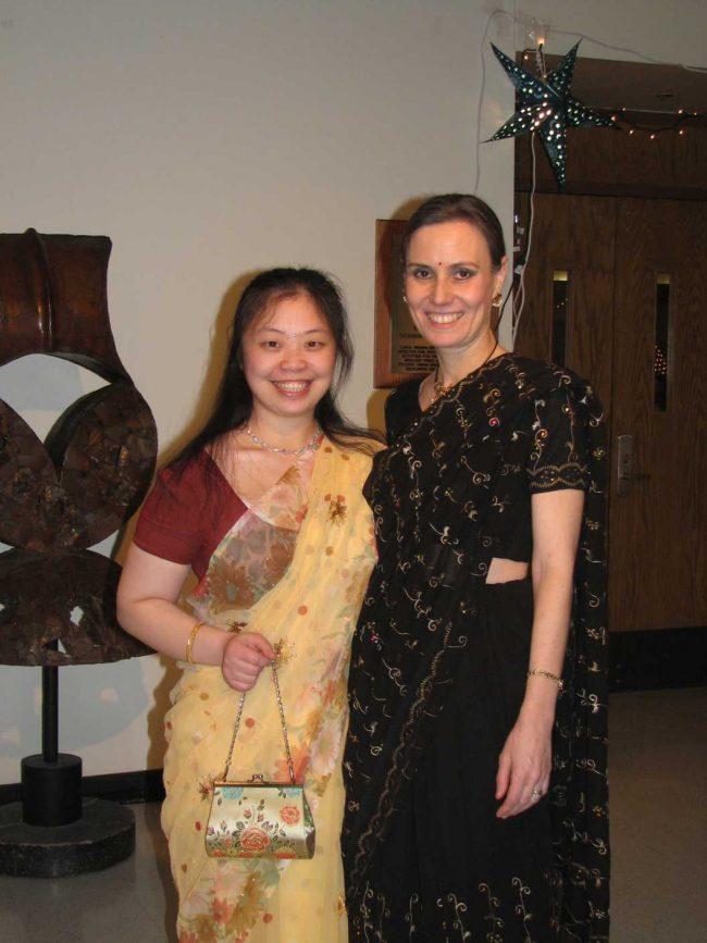 two women wearing sarees