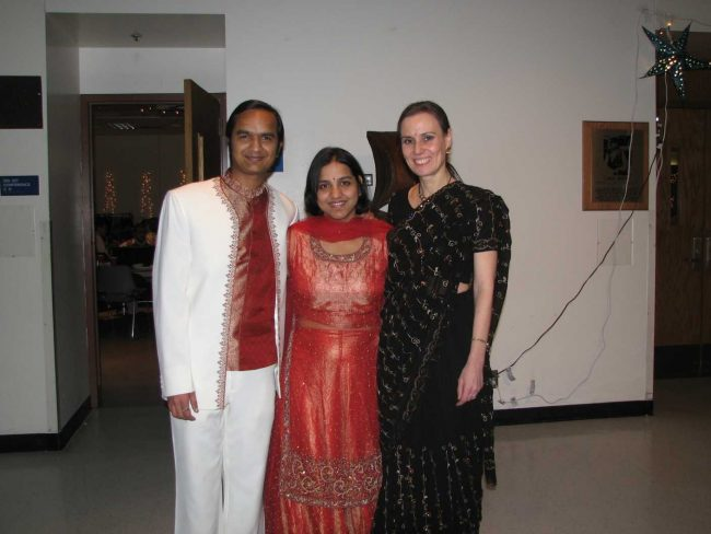 a young couple and an older woman traditional clothes from the sub continent