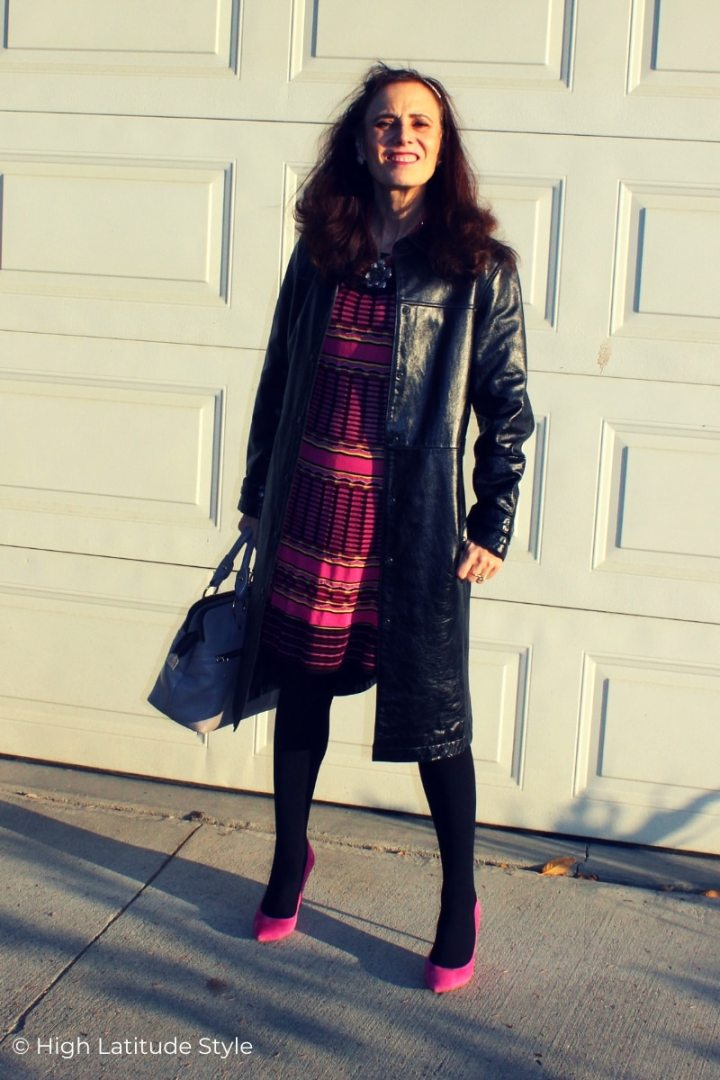 style book author in leather coat, knit dress, tights and suede heels