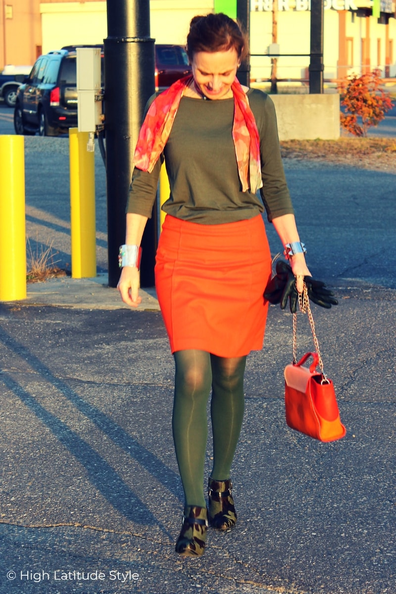 over 50 years old woman in fall colors work outfit withskirt, top, scarf