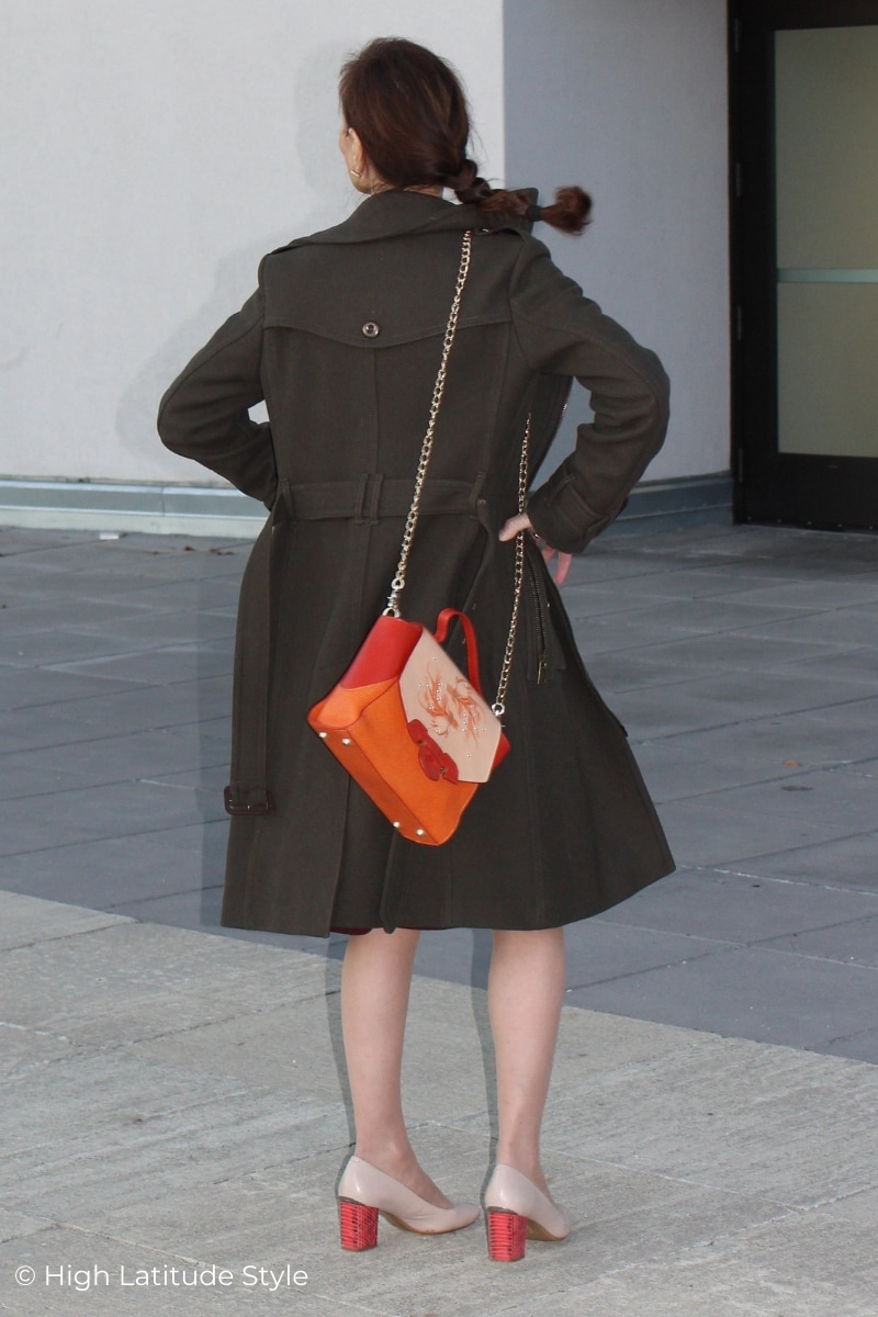 woman in cold season outdoor look with orange bag and red heels