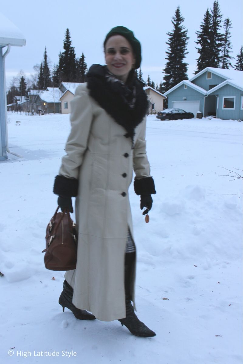 Alaskan woman in maxi quilted leather coat with faux fur trim