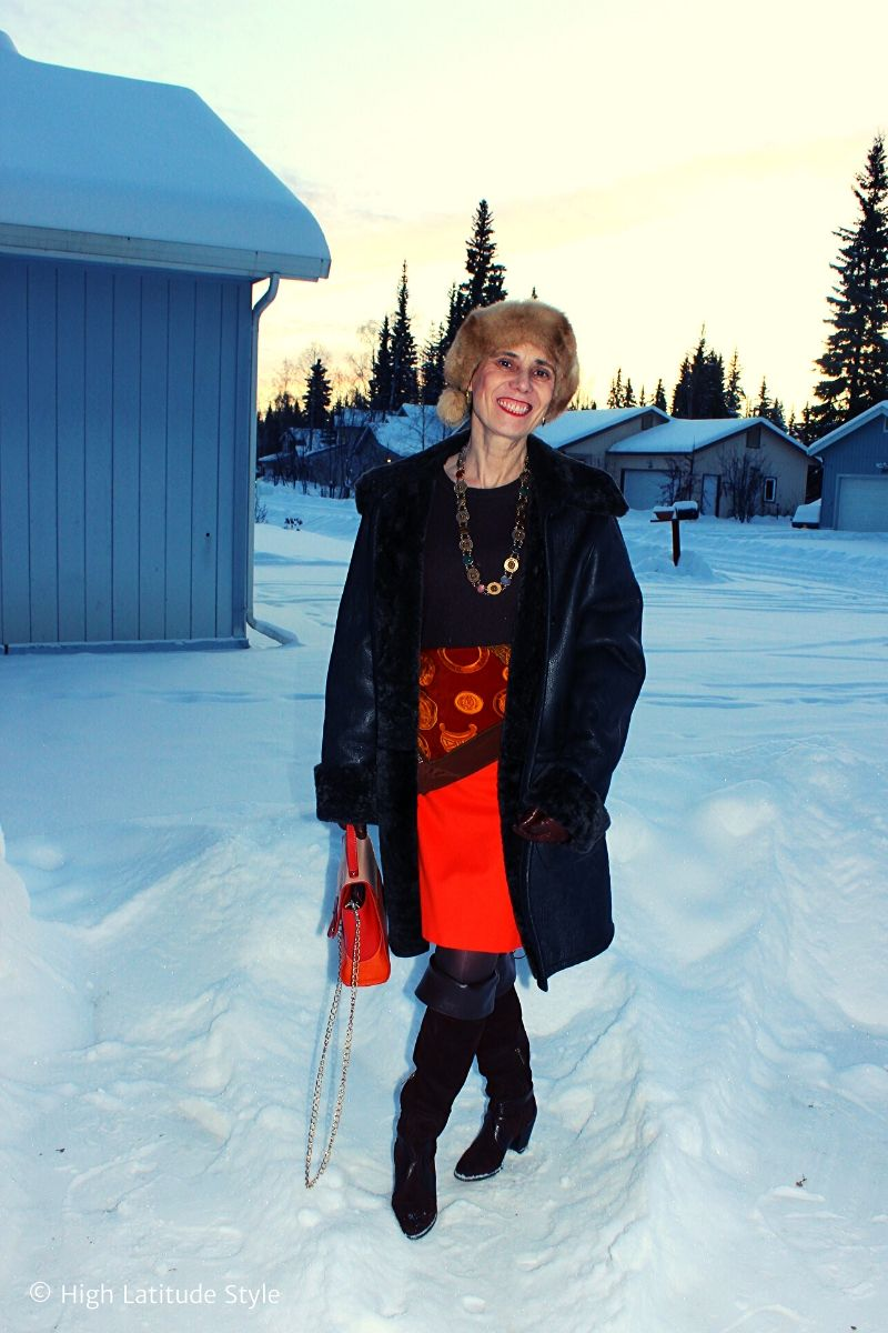 style blogger Nicole in Thanksgiving outfit with scarf, sweater, coat and boots in traditional colors