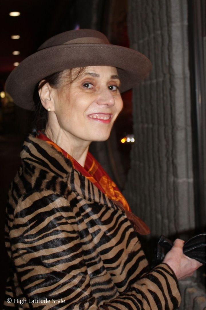Fashion blogger over 50 in animal print coat and Tenth Street Hats wool felt Scala round crown hat