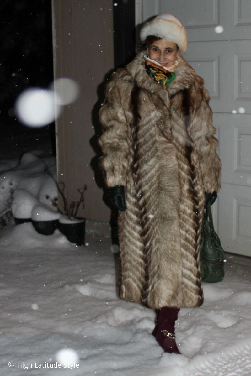 Alaskan blogger in festive winter outerwear with hat
