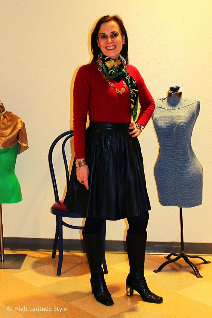 Nicole of High Latitude Style in pleated leather skirt, red sweater and holiday silk scarf