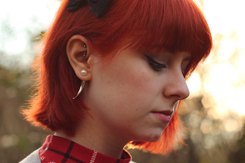 red head doning an edgy ear jacket