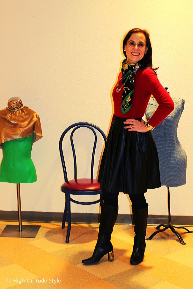 style book author in European holiday look with black leather skirt