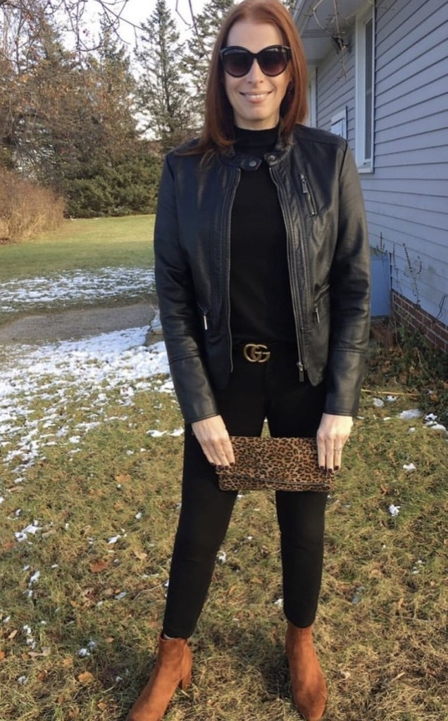 Top of the World Style Winner Jamie Ashcraft in black outfit with leather jacket brown booties and leopard print clutch