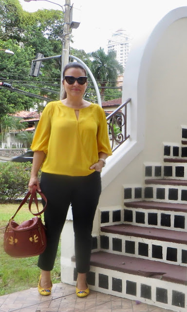 Top of the World Style Winner Lorena in yellow top and flats, black pants