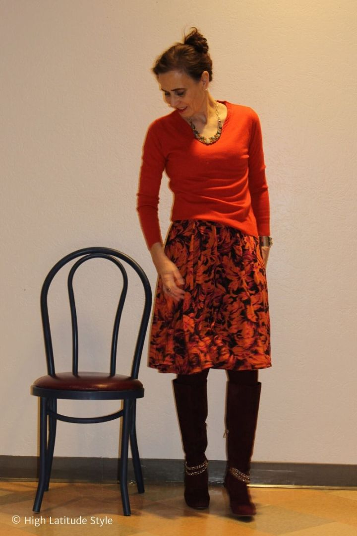 style blogger in winter look with dress as skirt and sweater