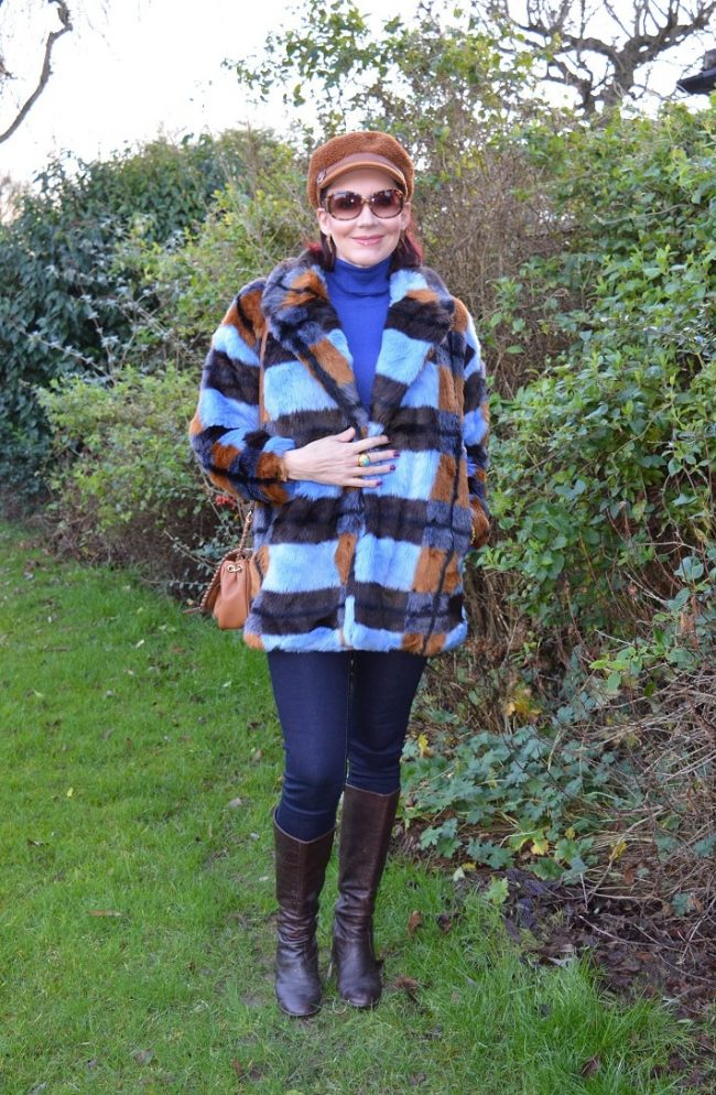 Emma of Style Splash in an example of chic cozy looks with Teddy jacket, balloon hat, jeans, boots
