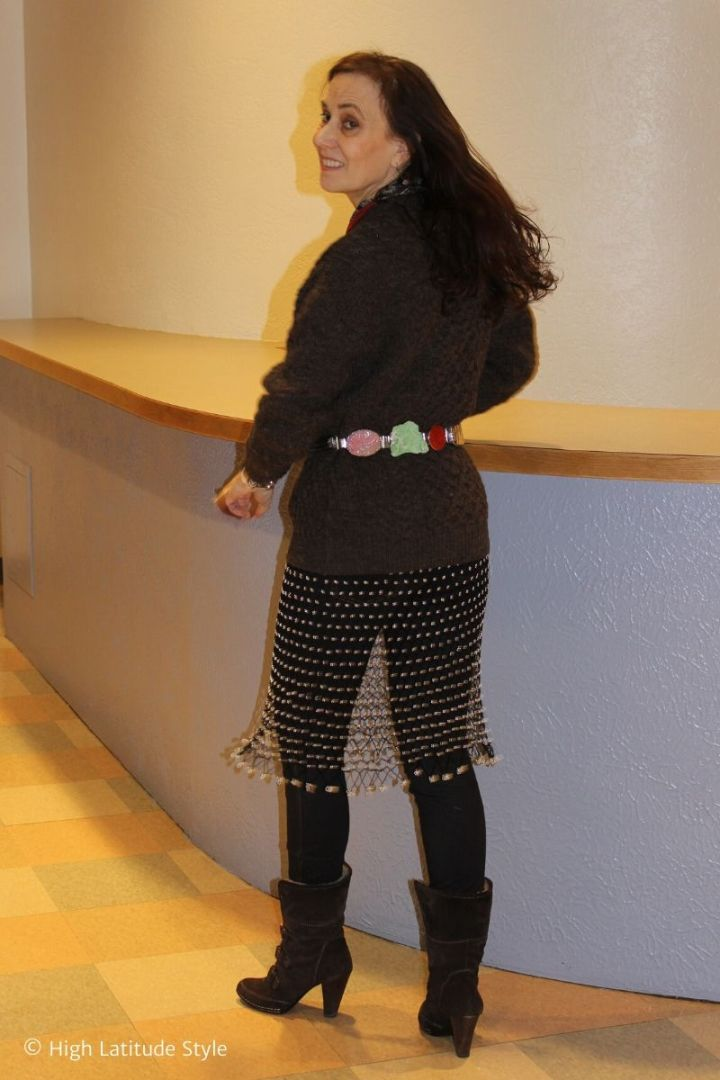 fashion blogger in meshdressover jeans with wool sweater and statement belt