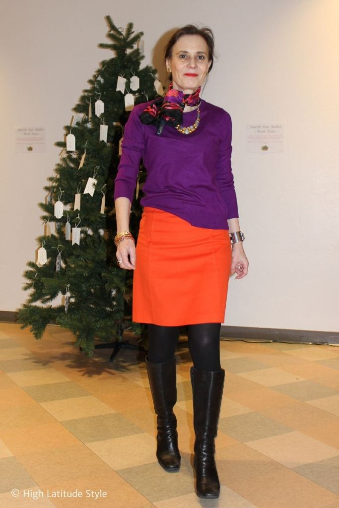 Alaskan blogger in work outfit with purple sweater, black boot and tights, floral scarf