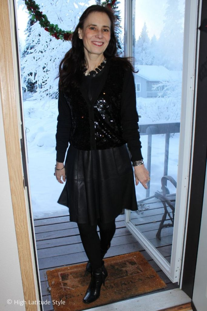 style blogger in Christmas look with sequin jacket, leather, tights and booties