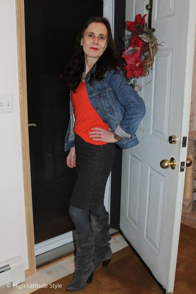 fashion blogger layering a sweater and denim jacket styled with tweed skirt, tights, slouchy booties