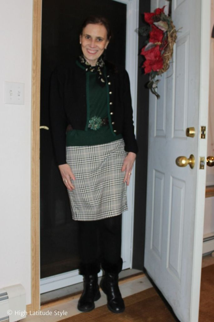 Alaskan woman in houndstooth skirt, janker, sweater, belt, tights and riding boots