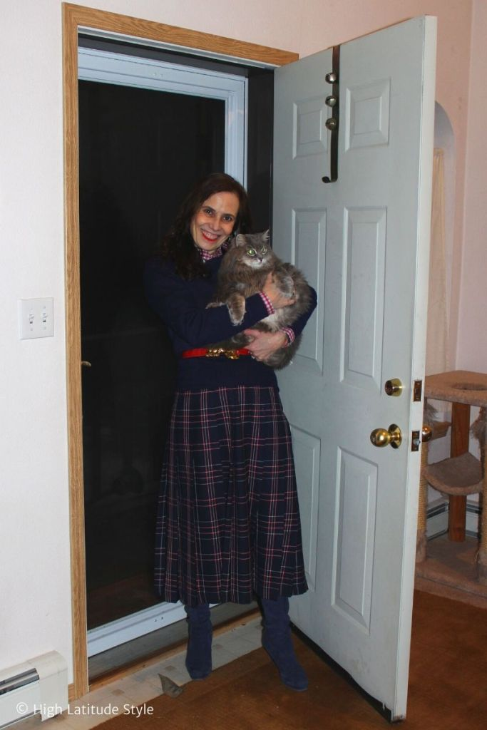 Alaskan blogger with cat in plaid midi skirt, sweater, shirt and boots
