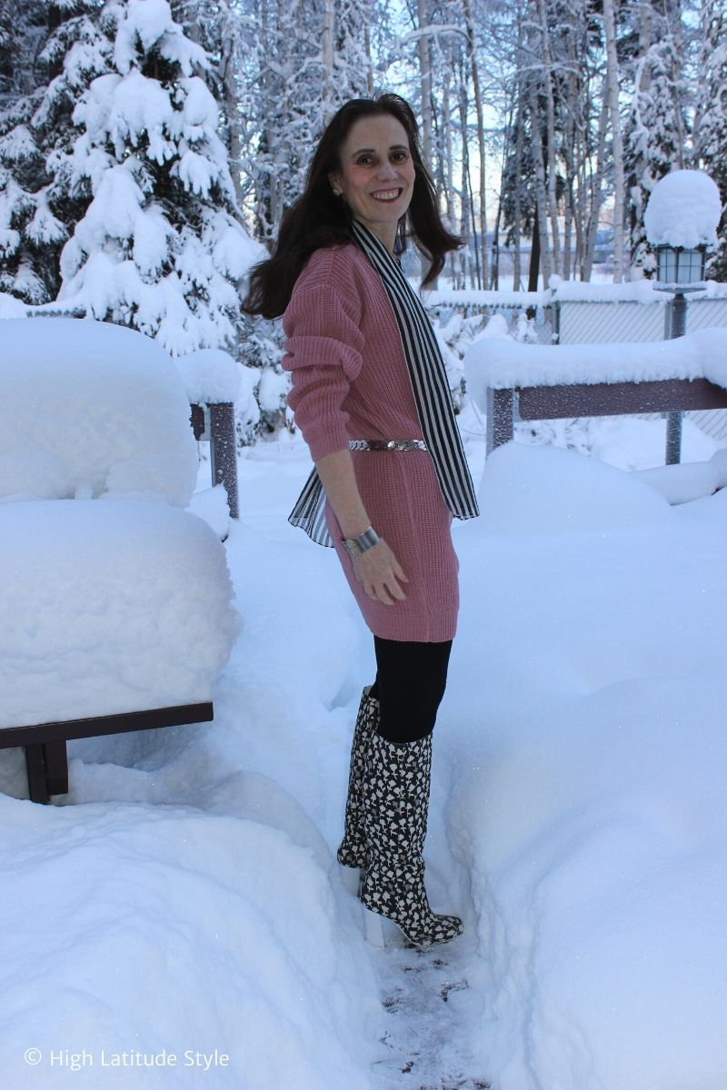 Femme Luxe pink jumper with tights, flower print boots, statement belt, striped scarf