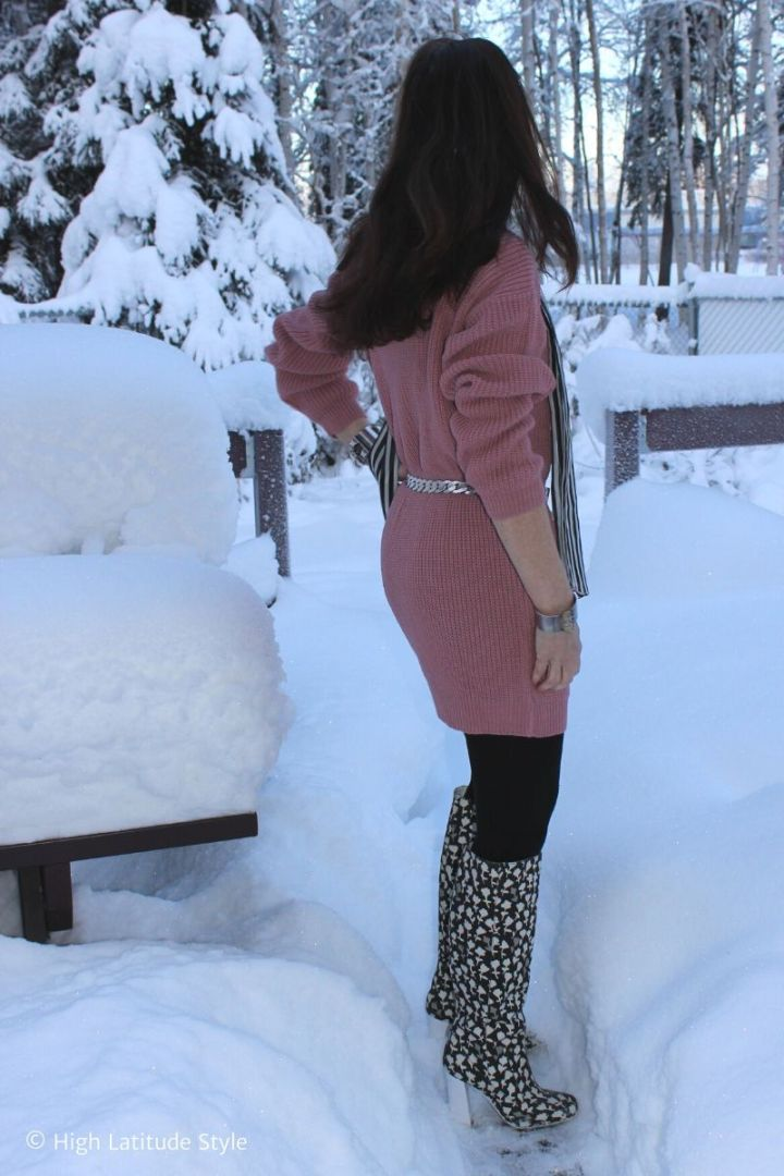 Stylist in femme Luxe pink jumper dress, scarf, tall boots