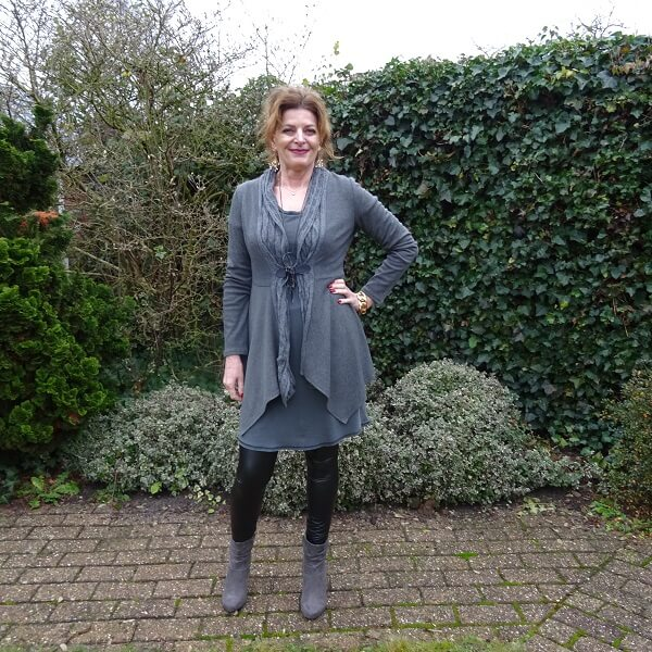 Top of the World Style Winner Nancy in gray knit dress and booties with leather leggings
