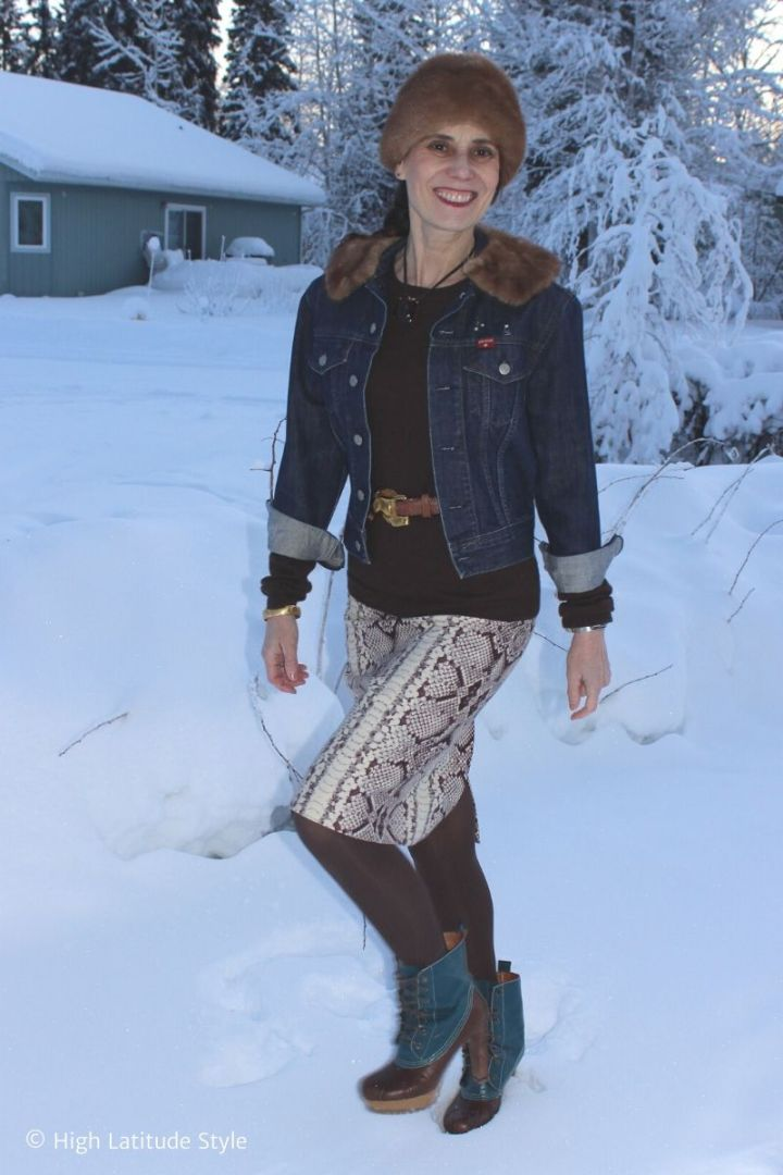 stylist in jacket, sweater, skirt winter outfit with heeled duck booties
