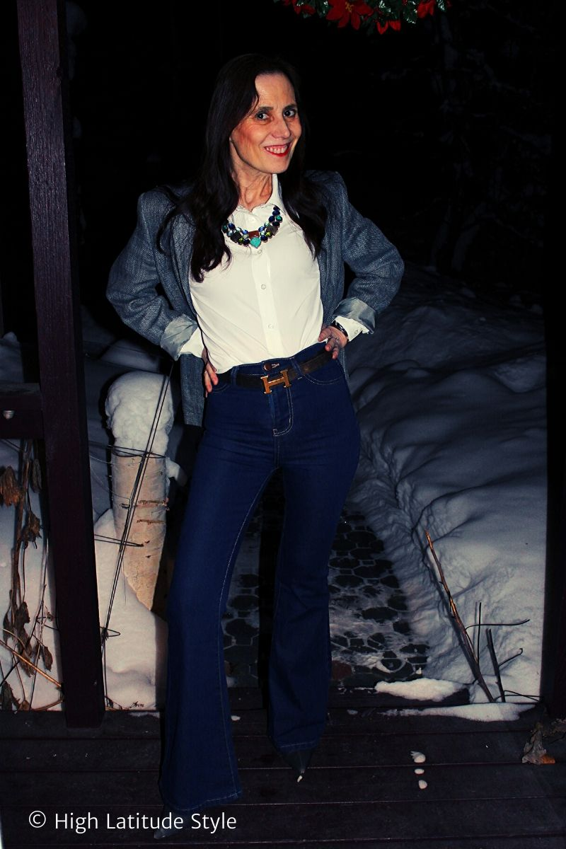 fashion blogger in American Classic style with denim pants, linen jacket, white button down shirt