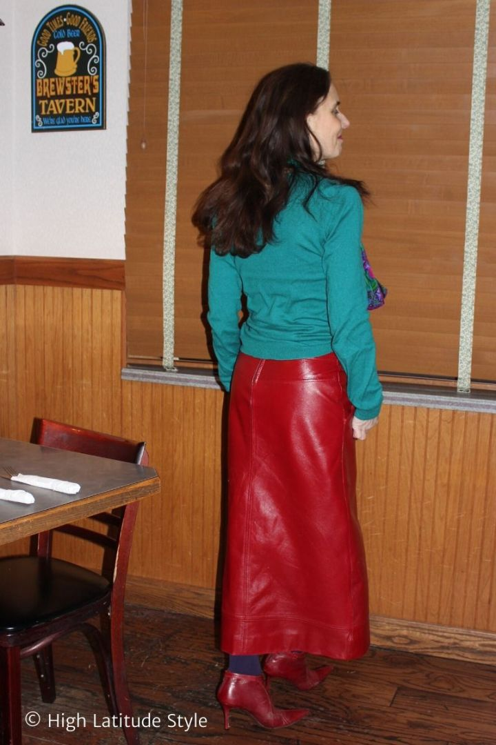 over 50 years old blogger in maxi leather skirt, sweater, tights, booties