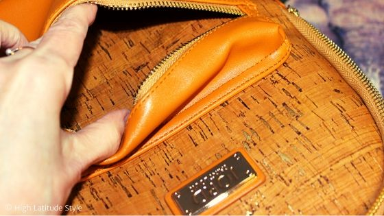 Zoom-in on the front pocket for details of zipper, material