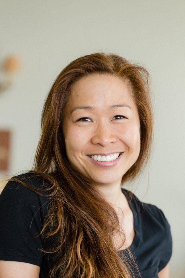 Author Christina Chiu in black scoop neck t-shirt