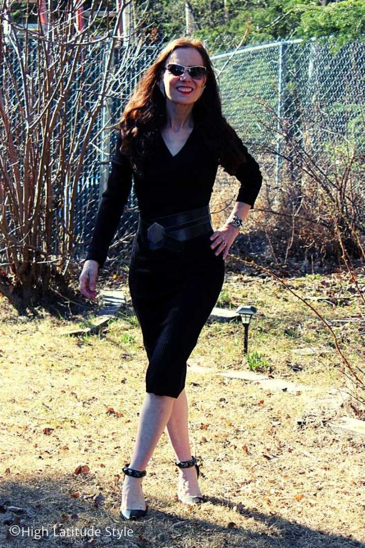 fashion blogger in sleek black Femme Luxe ribbed knit midi dress, studded heels, wide belt and sunnies