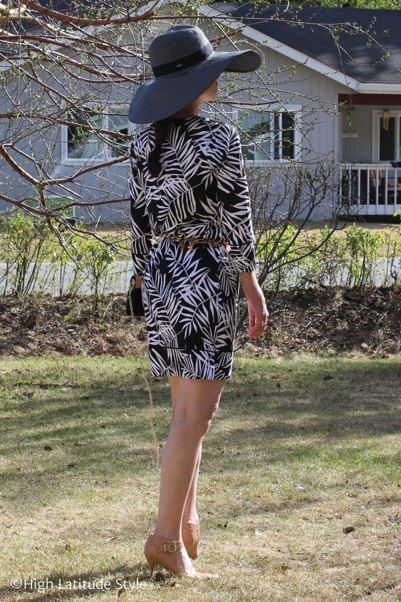 Alaskan woman in mini dress, hat, heels walking