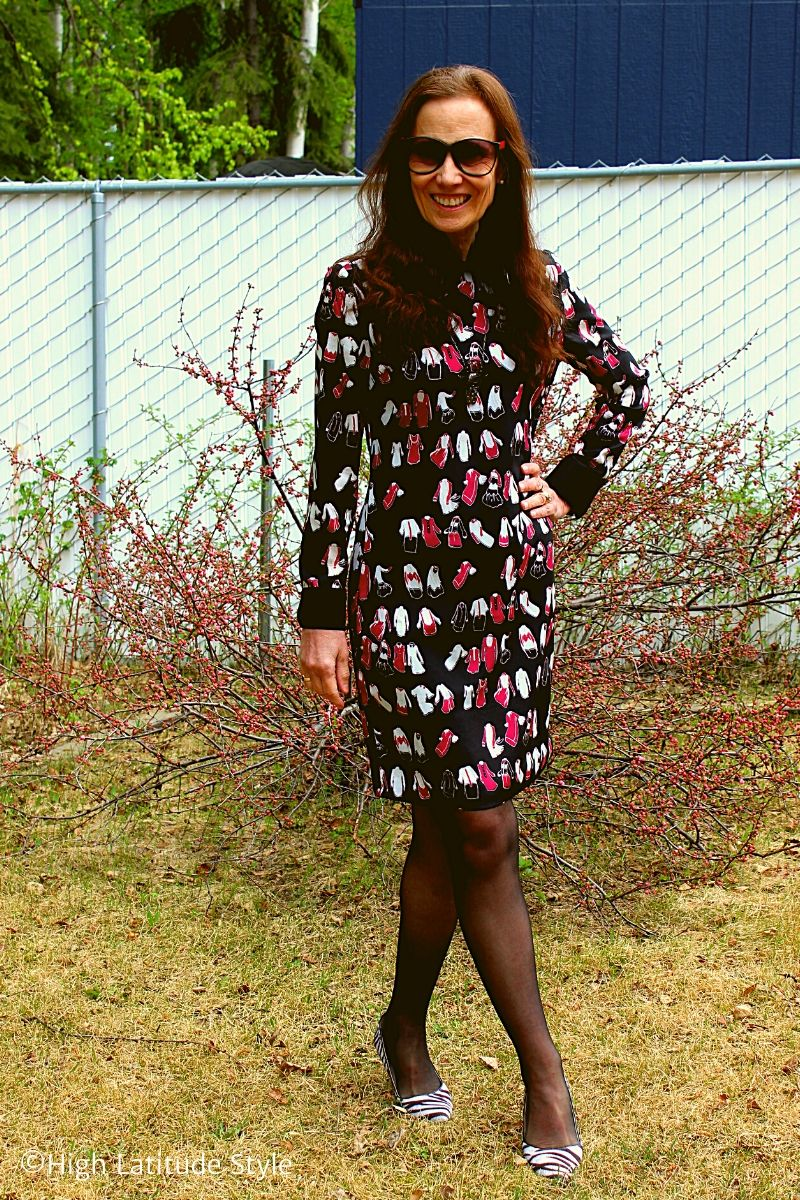 over 50 years old blogger in black sheer tights and red white black dress