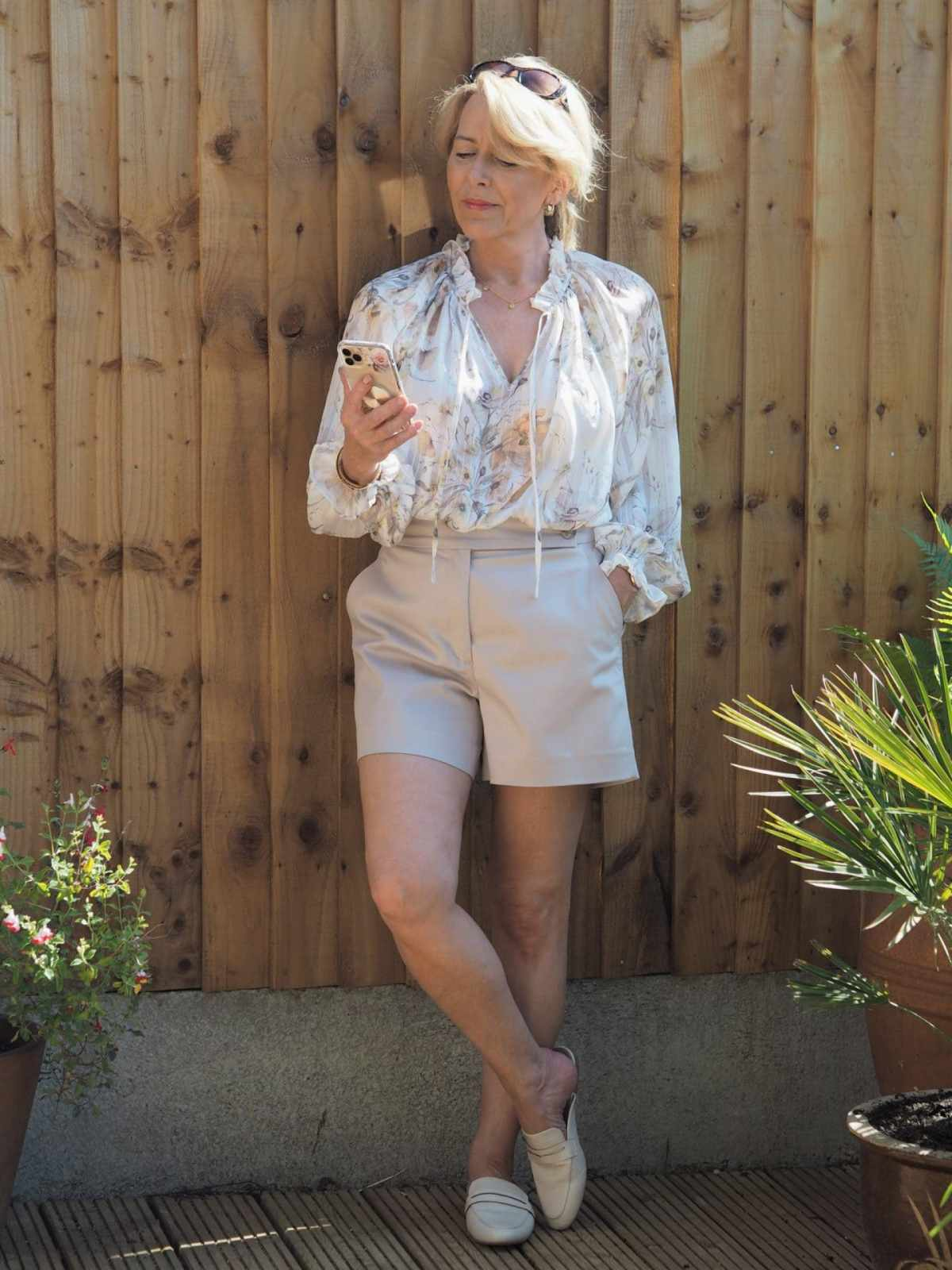 Readers' fav Laura in shorts, slides and floral blouse