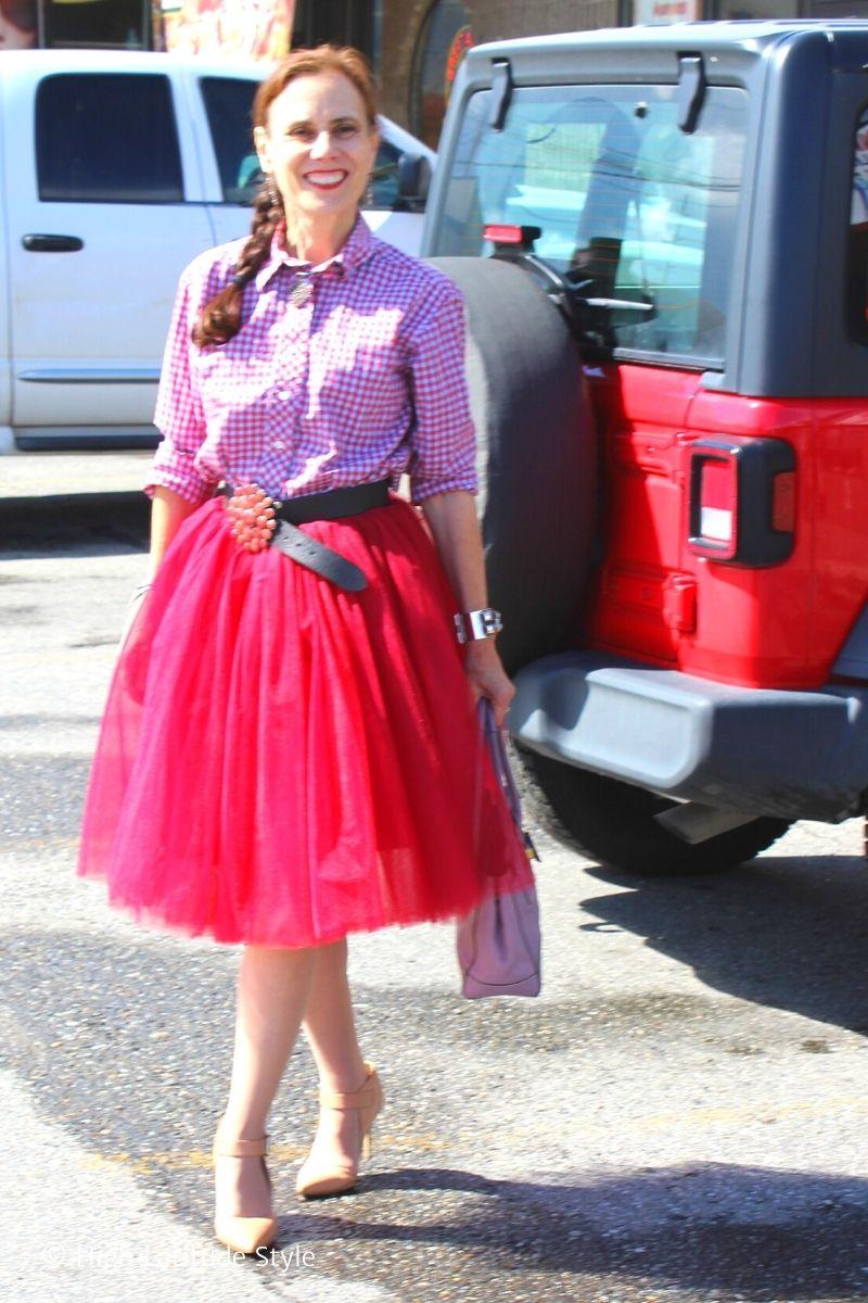 style blogger in gingham skirt, tutu, statement belt, heels, top handle bag