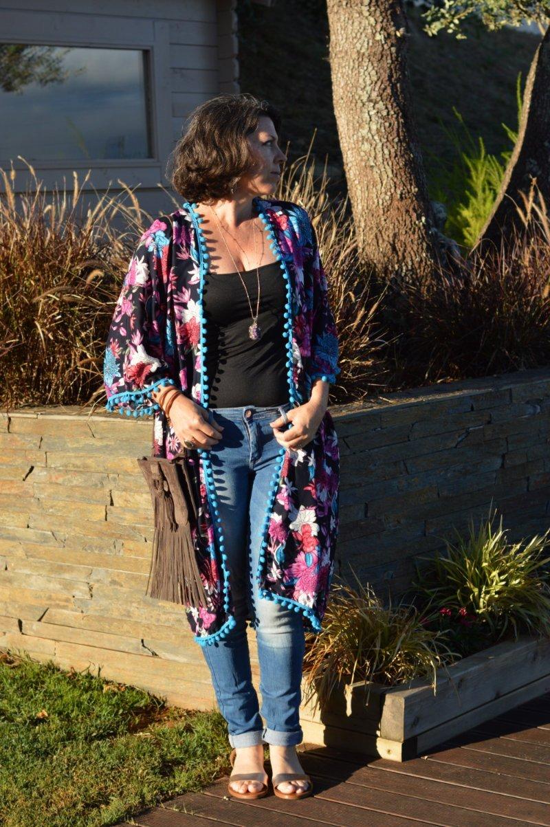 Suzy Turner in jeans, top, floral kimono