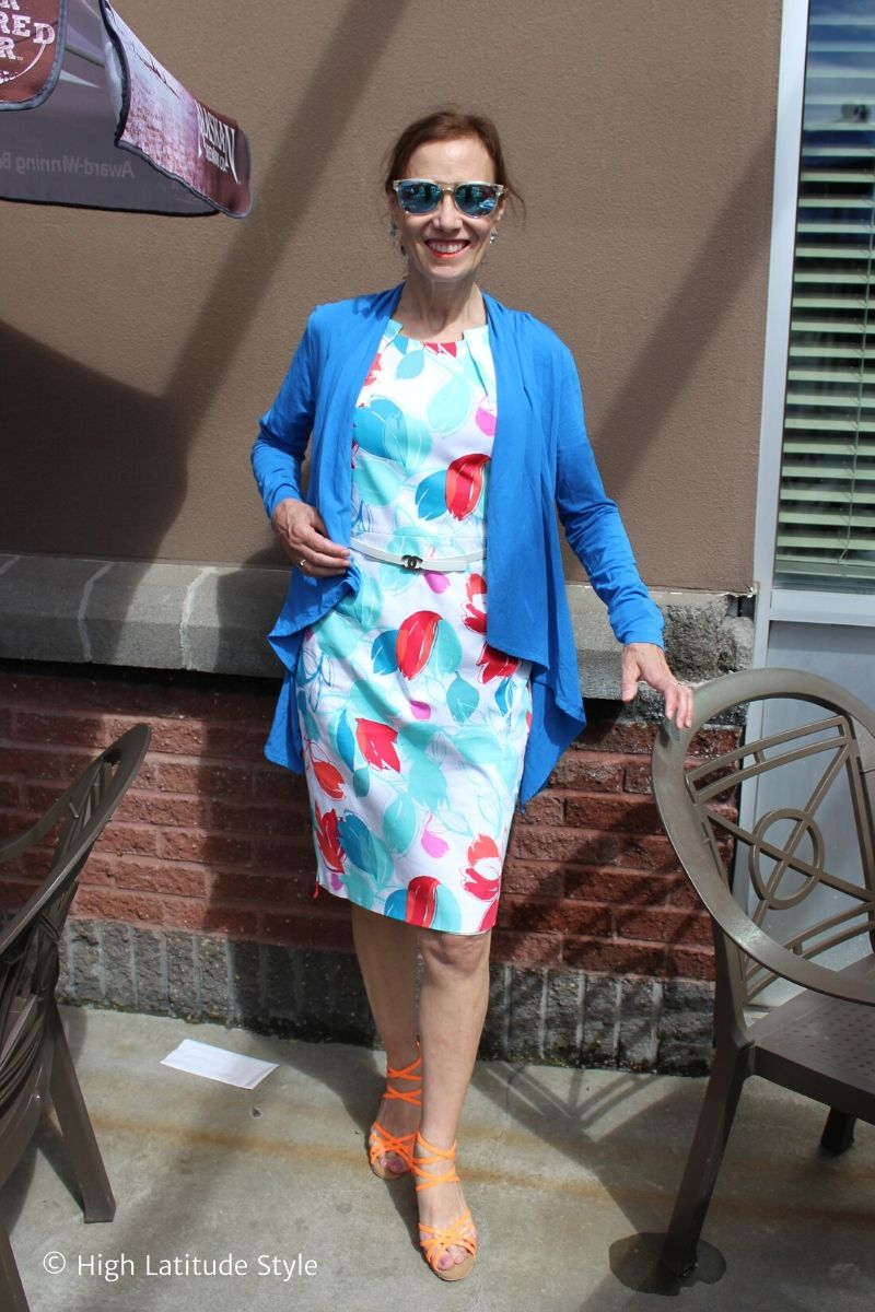 stylist Nicole in white with red, pink, blue and turquoise print and orange shoes