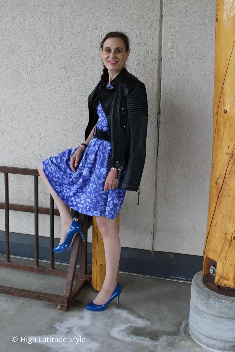 over 50 years old woman in floral dress with belt, matching pumps, pantyhose, black leather jacket