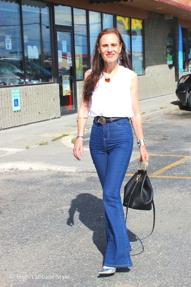 example of over 50 years old woman in high-raise denim pants, white shirt