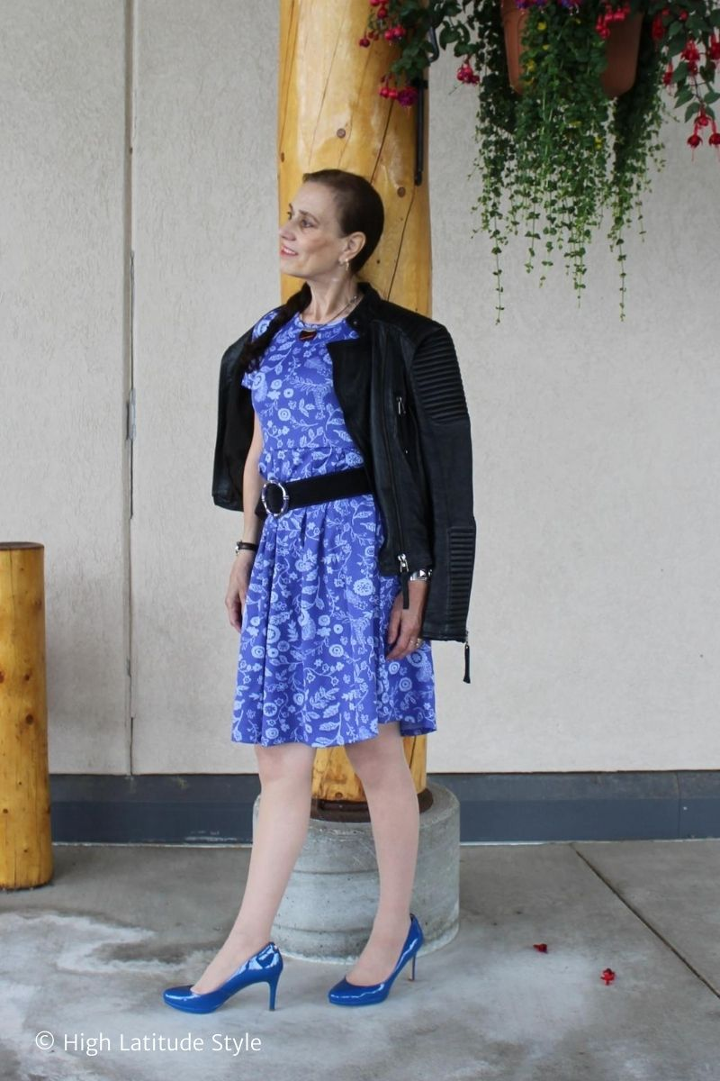 fashion blogger Nicole in pleated skirt dress with motorcycle jacket, pantyhose, patent leather heels