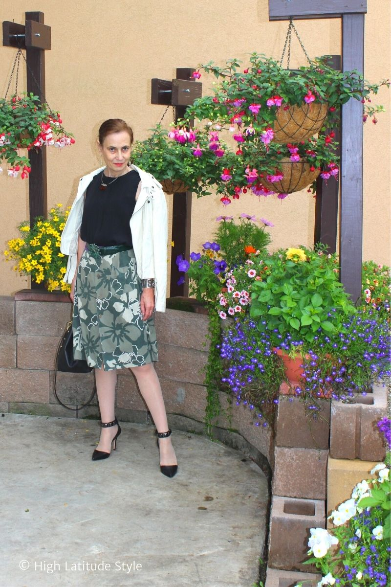 stylist in summer to fall transitional separates of skirt, shirt, pantyhose jacket