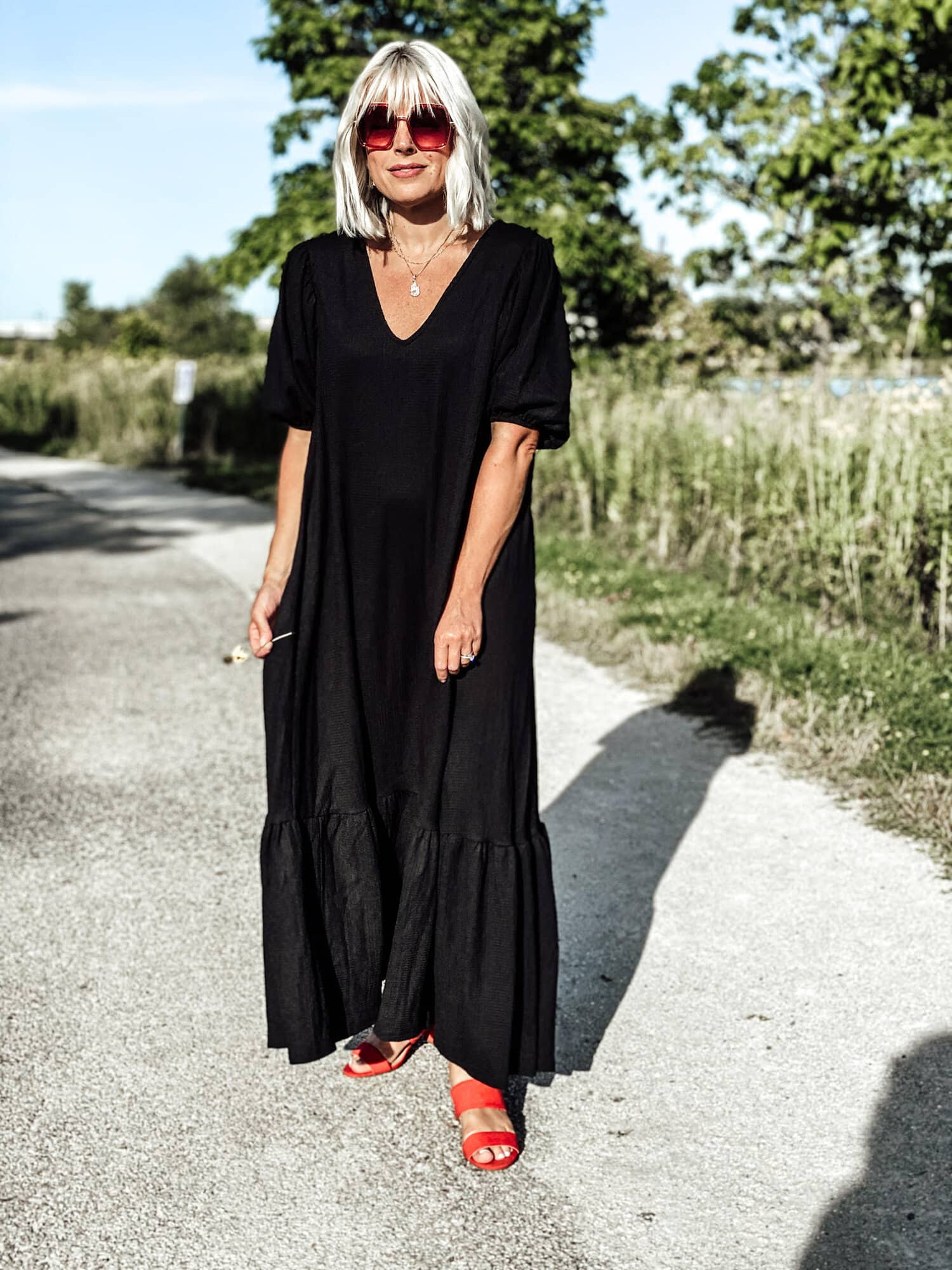 Johanna Grange became the Top of the World Style winner in her black maxi dress with red mules