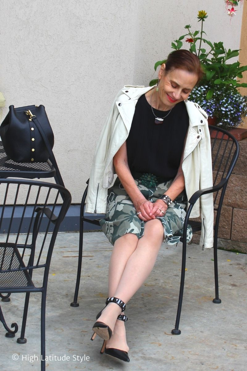 Nicole in transion season outfit with silk skirt, shirt motorcycle jacket