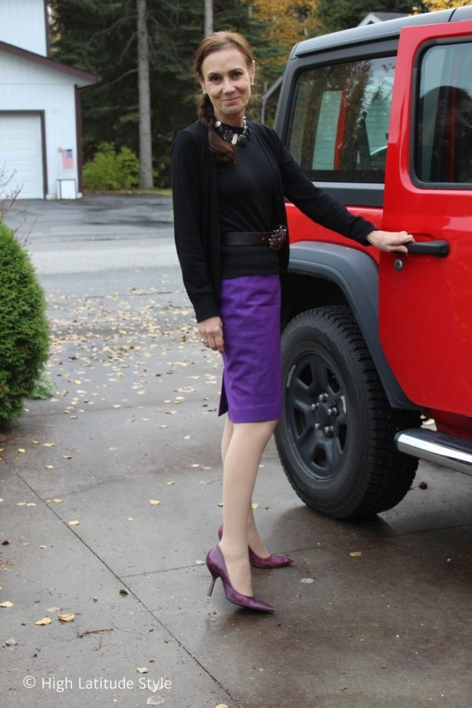 fashion blogger over 50 in opaque pantyhose, skirt, twinset, pumps work outfit