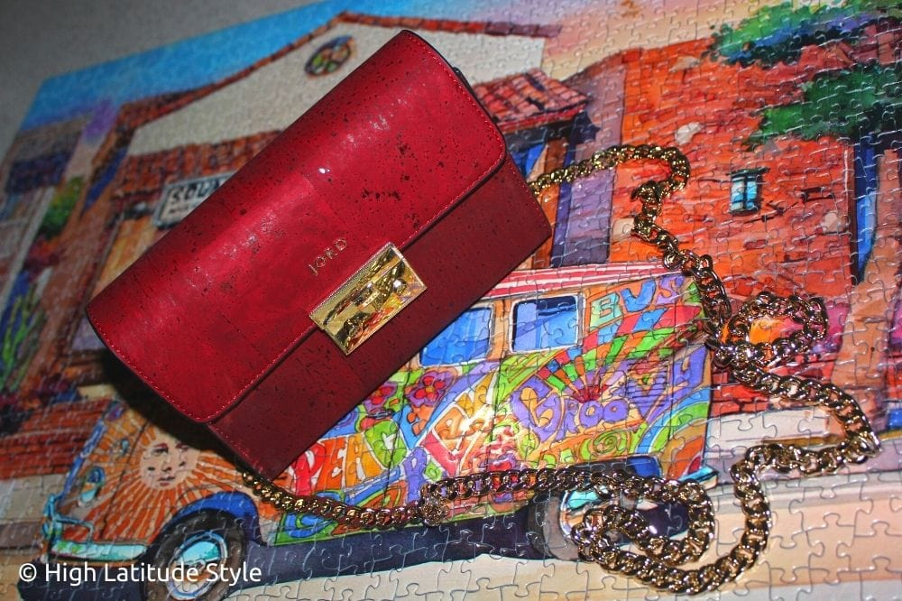 close-up of cork vegan purse with detachable golden chain